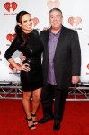 Elvis Duran and Carolina at the iHeart Radio Music Festival